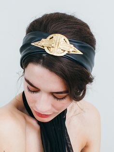 The statement and luxurious golden brass detail and leather on our Jennifer Behr Galactic Leather Turban toughens up a girly updo or chignon.