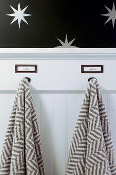 source: Rambling Renovators | library label holders over towels on hooks