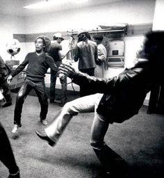 Bob Marley and Jimi Hendrix playing Football