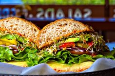 Veggie (Alfalfa Sprouts, Roasted Red Peppers, Avocado, Pepperoncinis, Cucumbers, Lou's Special Sauce, on 9-Grain Roll)