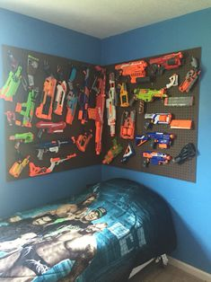 My sons nerf pegboard Arsenal The Effective Pictures We Offer You About large Nerf Gun Storage A qua Arsenal, Pistola Nerf, Nerf Gun Storage, Cool Nerf Guns, Scandinavian Bedroom, Boy Room, Kids Bedroom, Bedroom Ideas, Game Room