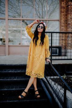 Feel like walking on sunshine with this beauty of a dress. It's girly, it's flattering, and it's bold. Just what we're looking for this time of year!