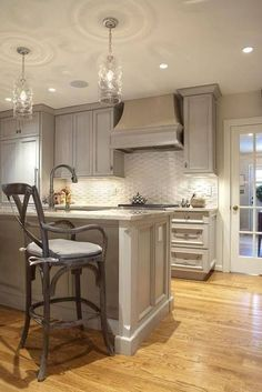 Soothing kitchen. Like gray cabinets and light floor.