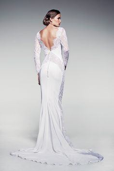 'Fleur Blanche' is the latest collection from Pallas Couture featuring French lace and mermaid shapes