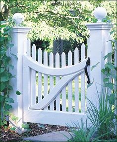 "Nantucket Picket Gate - The delicately curved brace and Sphere Post Caps give this 3' H, 3' W Nantucket Picket Gate with concave scallop top a sophisticated look. Gate includes 5 1/2"" square posts, a pair of black heavy reversible hinge straps and a black thumb latch. Stained white. Available in 3'H x 3'W, 3'H x 3 1/2'W, 3 1/2'H x 3'W, 3 1/2'H x 3 1/2'W."