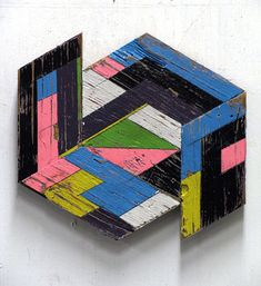 Aaron Moran's geometric sculptures from reclaimed wood have a graphic patchwork feel about them. The Canadian artist's works are full of patterns and colors where the found wood's grain and texture often show through giving each piece character.