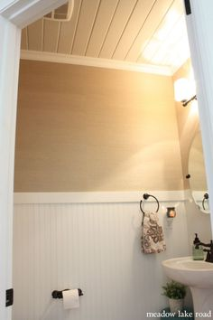 bathroom makeover with beadboard, grasscloth wallpaper and planks on the ceiling   www.meadowlakeroad.com