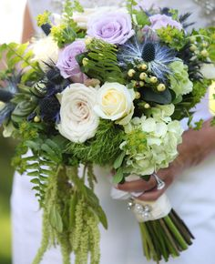 13 Modern Cascading Wedding Bouquets | https://www.theknot.com/content/13-modern-cascading-pageant-wedding-bouquets