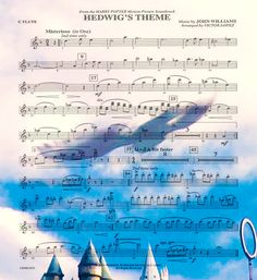 Sheet music for Hedwig's theme, overlaying a view of Hogwarts.
