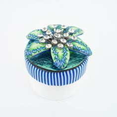 Daily artwork on the lid of a Carmex jar - polymer clay and SWAROVSKI ELEMENTS crystals (jar #31 out of 366) http://lisapavelka.typepad.com