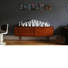 Retro sideboard and grey wall.