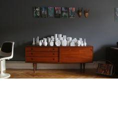 Retro sideboard and grey wall.