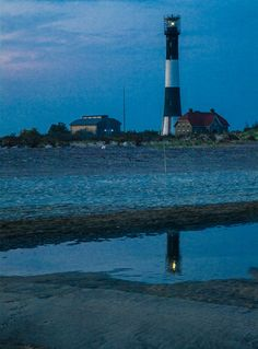 "500px / Photo ""Lighthouse Reflections at Dusk"" by Ralph Raiola"