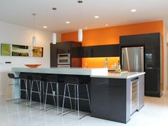 decorating with warm, rich colors | orange walls, white cabinets