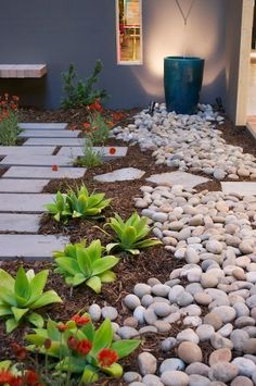 Great combination of smooth stone and rugged mulch for a contrasting look.