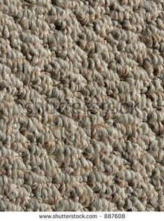 stock photo : detail of interior neutral colored berber carpet good for background or texture
