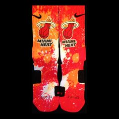 Miami Heat Inspired Custom Nike Elite Socks  Each pair is custom created when you order. There are minor flaws in each creation -- no two socks are the same.  These are authentic Nike Elite socks for sale. The design on the sock was not created by Nike, but was created and customized by me. T...