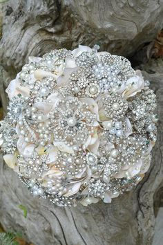 Brooch Bouquet, love the concept, maybe with a little more fresh flowers and slightly less brooches