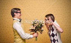 Man nerd giving flowers to his girlfriend — Stock Image #61113927