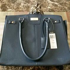 !! ONE HOUR SALE!!!  NWT! BCBG PARIS HANDBAG Nwt! MAKE AN OFFER!! Navy BCBG PARIS Handbag. Awesome looking bag!! BCBG Bags Shoulder Bags