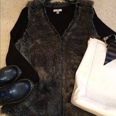 NWOT! Faux Fur Vest NWOT! Grey furry vest. V-neckline. Hook & eye closure down front. Slash hand pockets. Never worn. Ava & Viv Jackets & Coats Vests