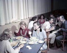 Grace Kelly in a canteen sharing a table with Ann Blyth and Janet Leigh. In the background you see Elizabeth Taylor and Stewart Granger. (Photo by Gene Lester, c. 1954)