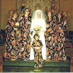 Interesting group picture of a bride and her bridesmaids