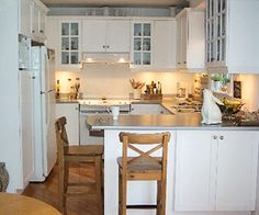 This is the kitchen that I would like to have. It looks clean, cozy, and organized.
