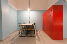 Modern room looks like prison with table and iron locker in a hostel for students