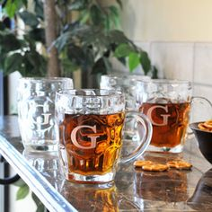 Classic Beer Tankards (Set of 4): It's time to sip in celebratory fashion with our Classic Beer Tankards (Set of 4) and give way to good, clean fun. Crafted of hand blown glass, this conventional pub set features a brilliantly contoured shape, weighted bottom, smooth handle for easy toasting and free personalization. Great for gift giving and receiving, the dishwasher safe steins will easily be loved by all for years - and 'Cheers!' - to come. $66 for a set of 4 online at Wedding Staples.
