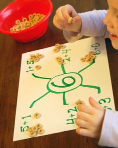Spider math!  Find all the ways to make a number with addition!  Use cheerios, candy, cereal, crackers, buttons, gems, etc