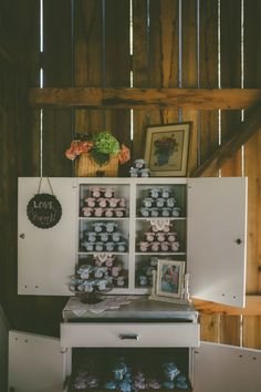 Jelly favors displayed in old hoosier cabinet | Barn Weddings KY | The Barn at Cedar Grove | Outdoor Weddings Receptions KY | Farm Wedding KY | Country Wedding Kentucky | Rustic Chic Wedding Reception Venue KY | Barn Event Space Kentucky