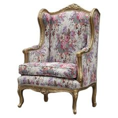 queen anne wingback chair gold rimming with either satin or velvet material long pillow