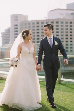 Tracey and Jordan on the Crown Towers Melbourne rooftop. #weddingvenue #melbournewedding #realweddings