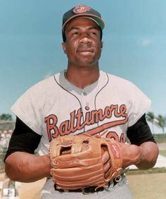Portrait of American baseball player Frank Robinson first baseman outfielder and slugger for the Baltimore Orioles wearing his uniform with his glove. Baltimore Orioles Baseball, Baseball Star, Tigers Baseball, Baseball Tickets, Baseball Cards, National Baseball League, Negro League Baseball, National League, Mlb Players