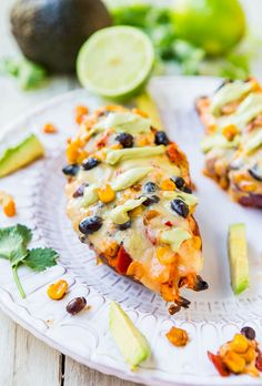 Cheese, Black Beans, and Corn-Stuffed Sweet Potatoes with Avocado Crema (vegan, GF) - A healthy meal that's easy, ready in 15 minutes, satisfying & doesn't taste like health food!