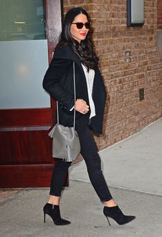 Olivia Munn in a white sweater, black skinny jeans, blazer and heeled booties - click ahead for more winter outfit inspiration from celebrities