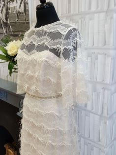 Beautiful eyelash fringed tulle is the eye-catching feature of our new Grace wedding dress. Perfect for the modern, stylish bride looking for a one-of-a-kind wedding dress.