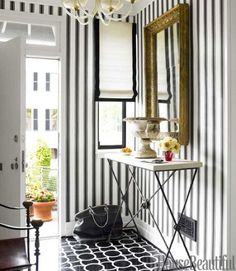 striped wall p0aper, mirror, shades and flooring