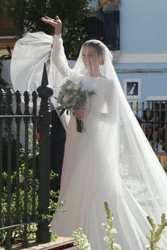 Elegant modest wedding dress with long sleeves and long veil