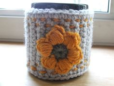 Crochet Coffee Cup Cozy with Puff Stitch Flower. $7.50, via Etsy.