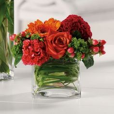 pretty arrangement in a glass cube vase