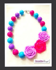 Our Pretty Posie Pink & Purple Bubblegum Bead Necklace with pink, teal and purple beads and featuring an three 3D roses in bright pink and purple for just $16.50 including shipping (untracked) anywhere in Australia. More designs available at www.bubblegumroyal.com