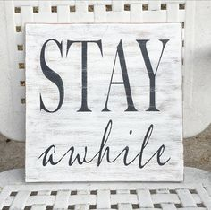 Stay Awhile Sign! This wooden sign will be the perfect addition to your farmhouse and rustic décor! Heavily distressed stained wood sign,then painted white with black painted lettering! Hangs by a sawtooth hanger or looks cute set on a shelf! Measures approximately 12X12.