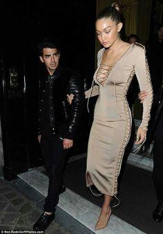 Gigi Hadid displays plenty of cleavage in nude tie-up dress as she hits the Paris Fashion Week party scene with doting boyfriend Joe Jonas