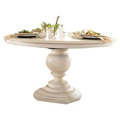 Gather friends and family for Sunday brunch or a celebratory meal around this charming dining table, showcasing 1 leaf and a turned pedestal base.