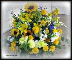 Large sunny yellow, white with a hint of blue ceremony flowers. Perfect bouquets for a garden wedding in August. Bare Mtn. Farm