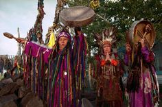 Shamans from the Tos Deer ( nine skies) association drumming their dungurs (drums) during a ritual.