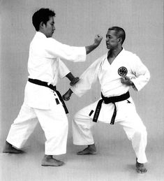 Two-handed pressing block, backfist strike