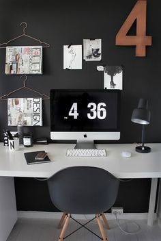 This dark & dramatic workspace is gorgeous! Particularly fond of the hangers to hold up magazines. {image}